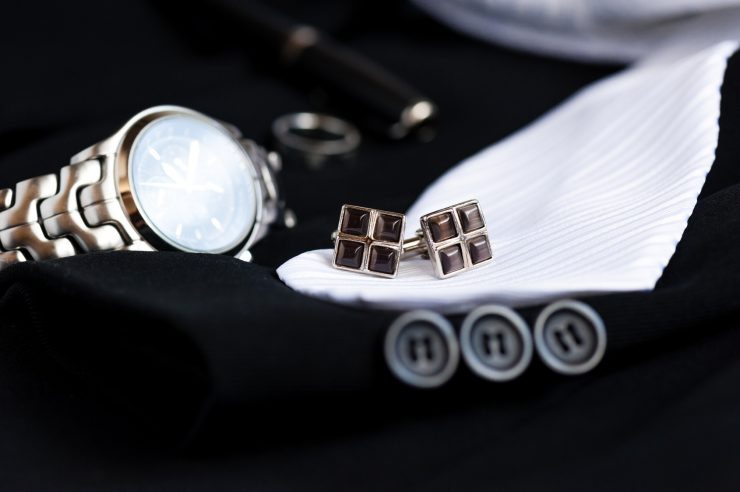 closeup shiny cufflinks with gemstones, accessory for men